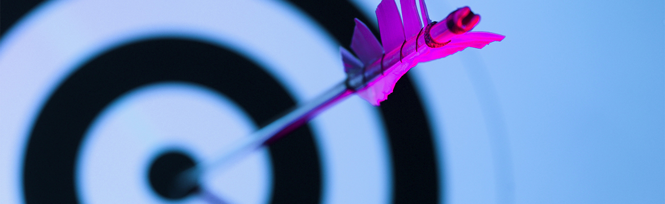 Close-up of arrow in bulls eye of target